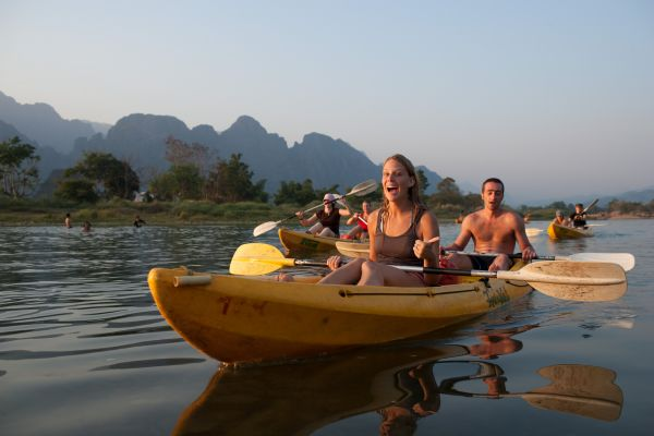 People in yellow kayaks on the Mekong river