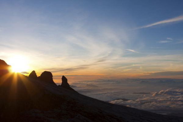 Sun rising behind a mountain peak in Borneo